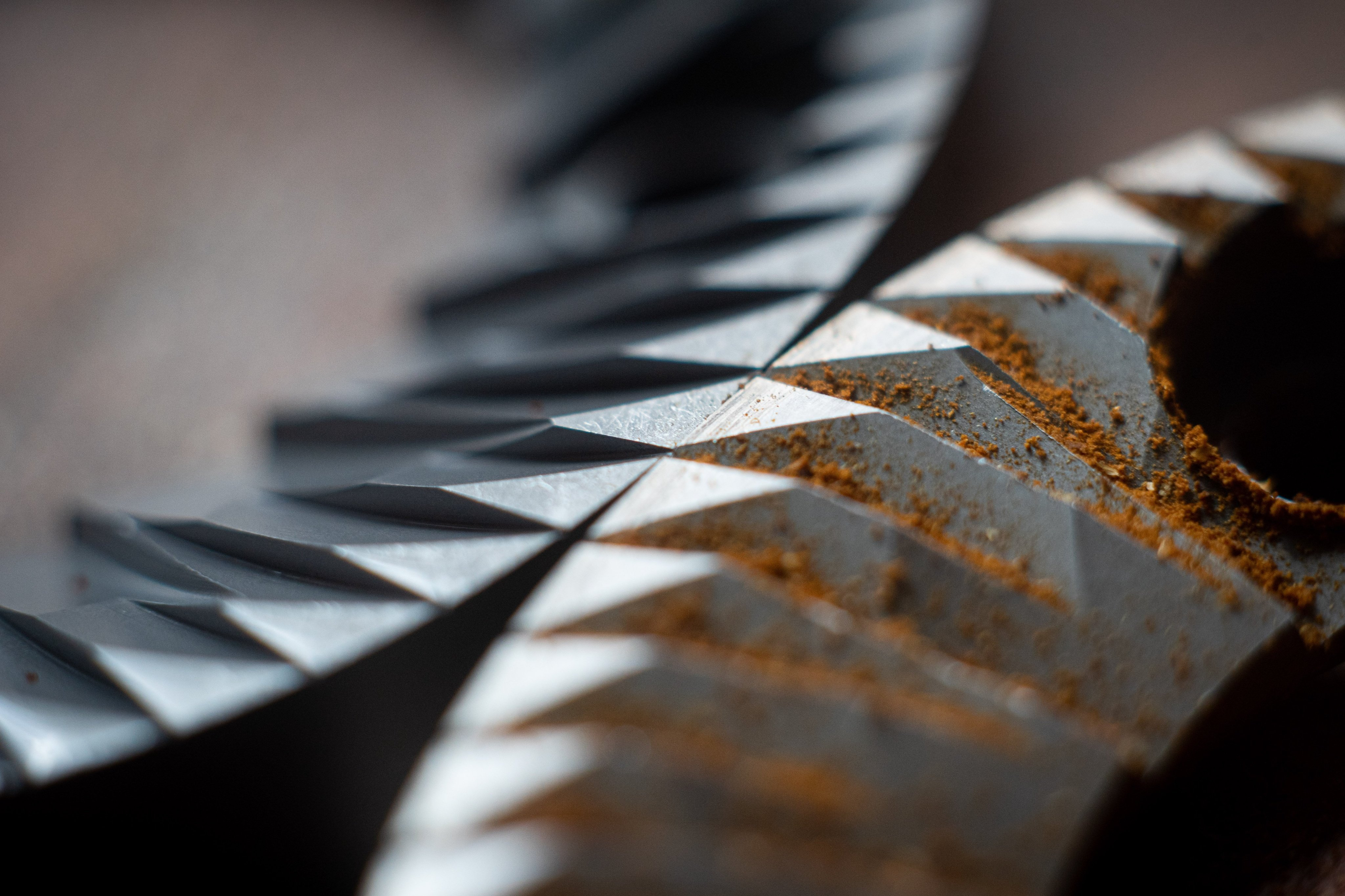Macro shot of coffee grinder conical burrs 1
